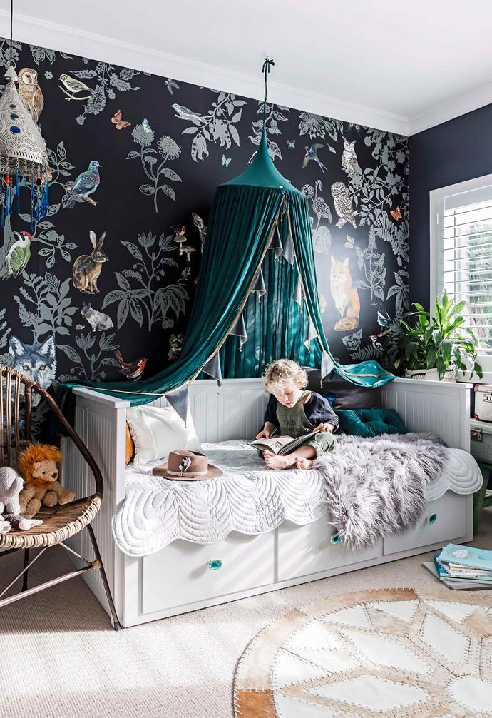 A striking wallpaper is an easy way to make a dramatic statement in the kids' room, instantly introducing a bold element to the space. In this kids' room a rich green canopy hangs over the framed white bed to add a dreamy touch.<br><br>