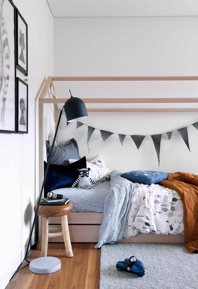 A playful house-shaped canopy bed frame in this kid's room adds a dreamy element, especially when paired with a string of bunting. A vibrant mix of patterned and colourful bedding is the perfect finishing touch.<br><br>