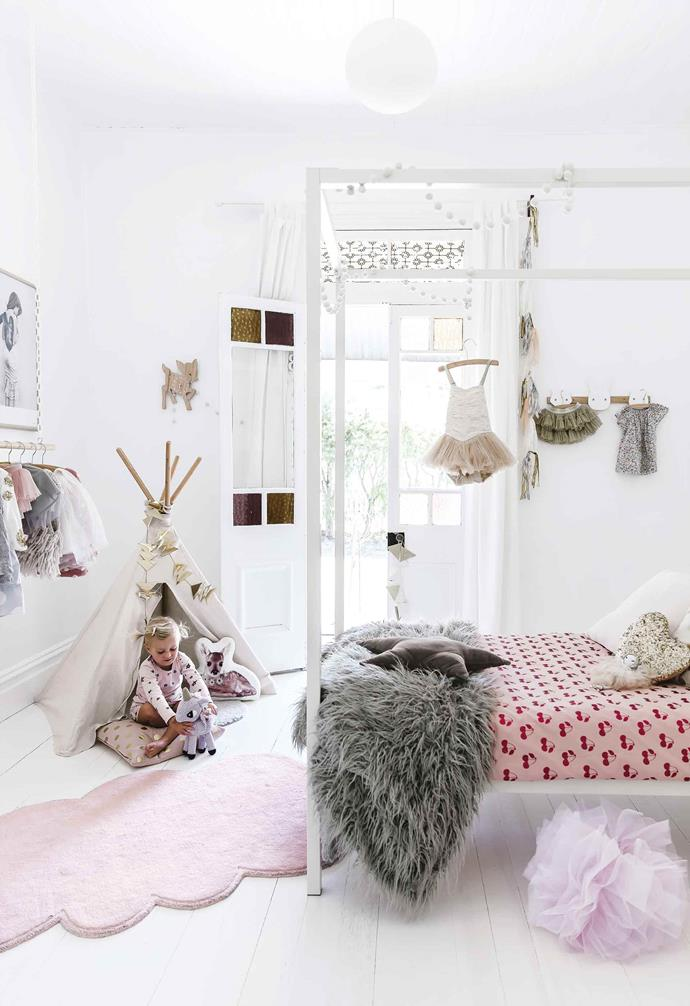 "A stark white canopy bed frame is paired with vibrant pink patterned bedding to add a romantic touch to the kid's bedroom in this [contemporary beachside home](https://www.homestolove.com.au/design-ideas-from-a-coastal-meets-rustic-family-home-17691|target=""_blank""). A hanging dowel against the wall is a chic wardrobe solution, transforming little Bertie's wardrobe into a visual feature.<br><br>"