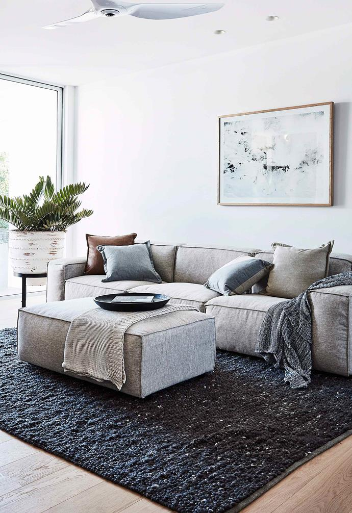 The low profile of this square-frame sofa adds a casual element to this living room.