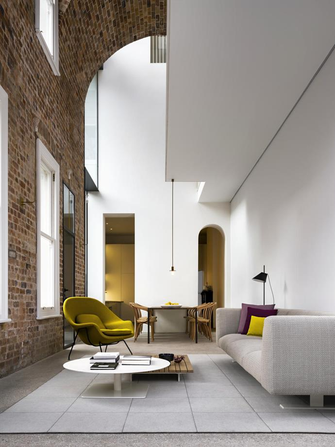 The dramatic arched ceiling designed by architect Renato D'Ettore is a striking feature of this revamped Sydney terrace. *Photograph: Justin Alexander*.