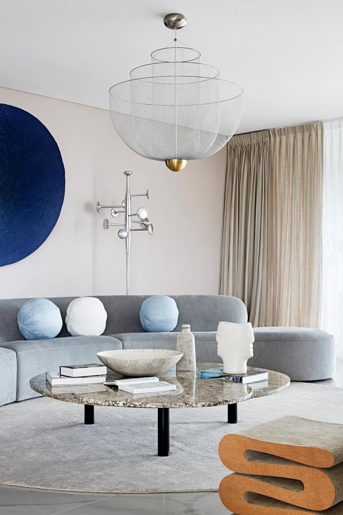 Interior designer Alicia Holgar carefully selected curvaceous furniture to complement the curved walls of this iconic Brisbane apartment building designed by Harry Seidler. Artwork by Ryan Hoffman from Liverpool Street Gallery. *Photograph: Shannon McGrath | Styling: Claire Delmar.*