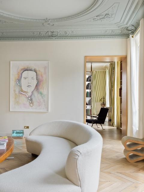 Vladimir Kagan's 'Serpentine' sofa and Frank Gehry's 'Wiggle' side chair adorn the living room of this Paris apartment designed by architect Alexandra Fain Sur. *Photgraph by Stephan Julliard.*