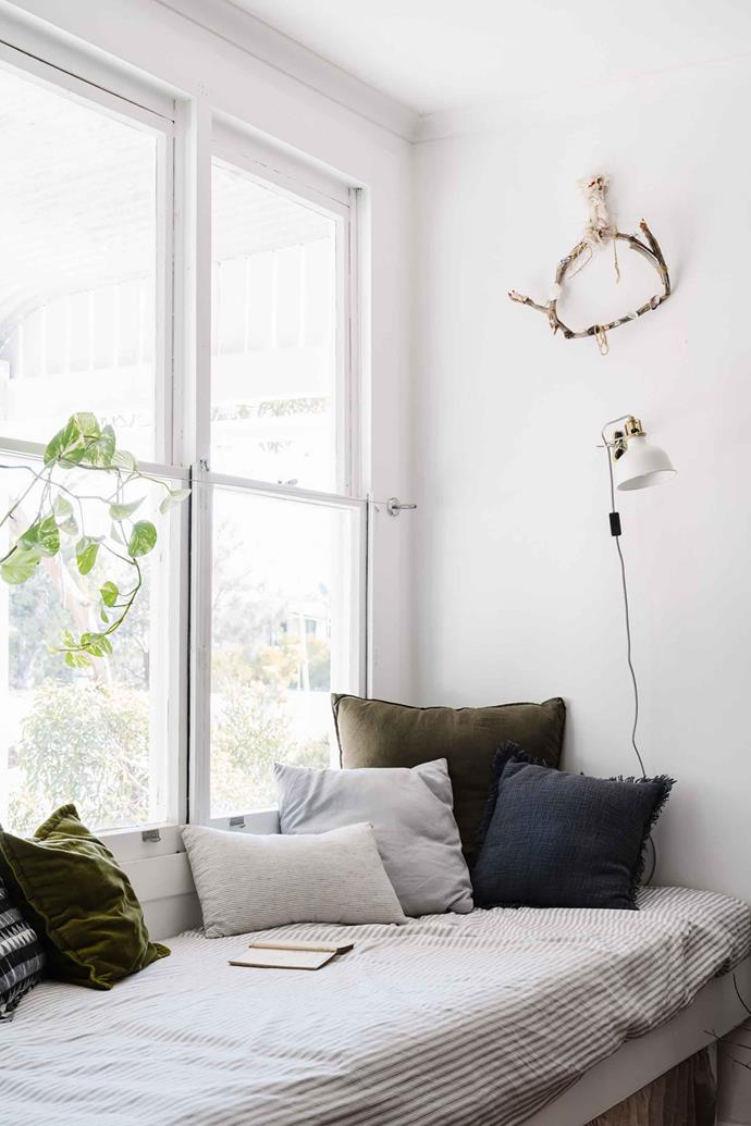 "They've created a beautiful and restful space with [daybeds](https://www.homestolove.com.au/daybed-ideas-19586|target=""_blank"") — perfect for afternoon naps — and a collection of vintage wares sourced from their favourite stores in Adelaide  and beyond. ""We have lots of daybeds to relax on,"" says Sarah. They built the daybeds from MDF and the ticking fabric was found at [Spotlight](https://fave.co/2UPAhfy