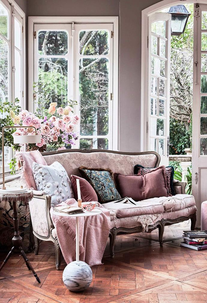The elegant curves of this sofa add a romantic touch to this living space.