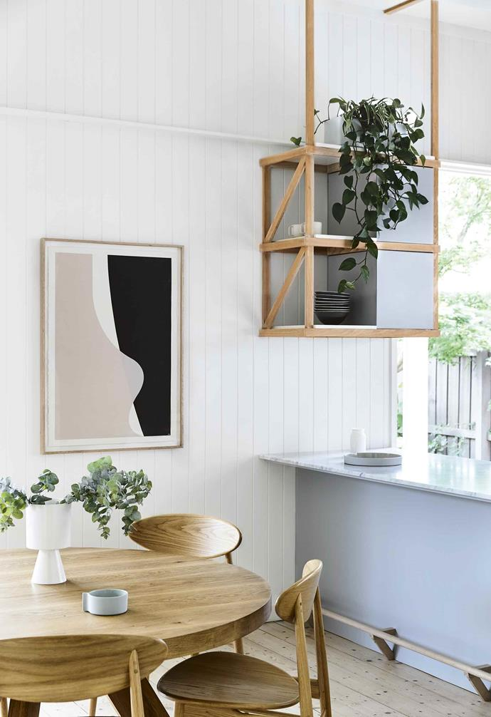 "Details such as the floorboards, [cornices, grates, pressed-metal ceilings and skirtings](https://www.homestolove.com.au/wall-mouldings-4309|target=""_blank"") were preserved and merged with new elements like archways, joinery and lining boards. ""We divided the house into three zones,"" says Berit. ""'The Light and Airy' living areas, 'The Comfy' bedrooms and 'The Calm' lounge.""<br><br>**Dining area** Warmth comes in the form of the generous [Mark Tuckey](http://www.marktuckey.com.au/