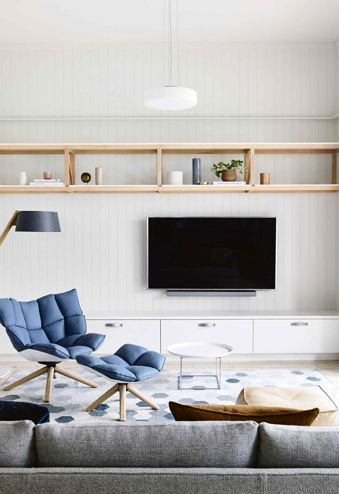 "The [open-plan](https://www.homestolove.com.au/20-best-open-plan-living-designs-17877|target=""_blank"") rear adopts a light palette with a beachy feel. An internal wall was pushed back for a more spacious communal zone, and tall, glazed sliding doors extend into the garden. [External blinds](https://www.homestolove.com.au/how-to-choose-blinds-19774