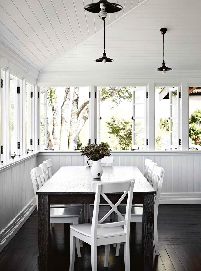 """Wraparound windows in the dining area take full advantage of the views. """"That's my favourite aspect,"""" Heidi says. """"I love to sit there and watch the sun stream in."""""""