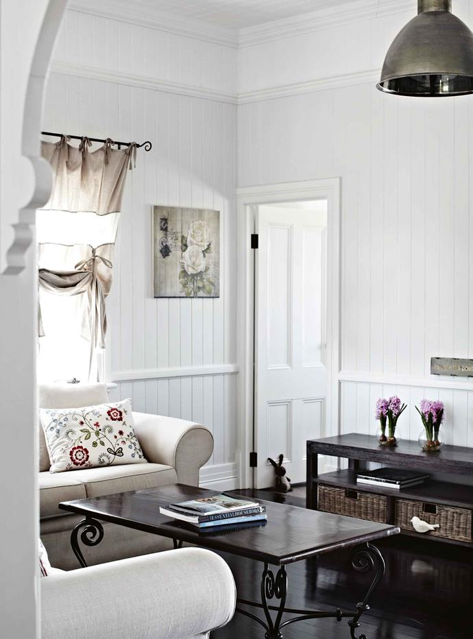 """A talented designer, Heidi chose a timeless colour scheme of white, black and grey for the interiors. """"It's a pretty classic combination and a bit of a blank canvas,"""" she says. """"I'm a bit eclectic and random — sometimes I want the house to feel more [bohemian](https://www.homestolove.com.au/bohemian-luxe-style-7167
