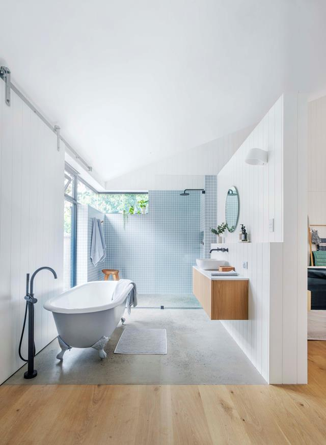 "This [open bathroom](https://www.homestolove.com.au/nordic-style-timber-clad-family-home-in-adelaide-19016|target=""_blank"") features a marine-grade plastic composite with customised vertical routing vanity wall that gives just enough textural interest."