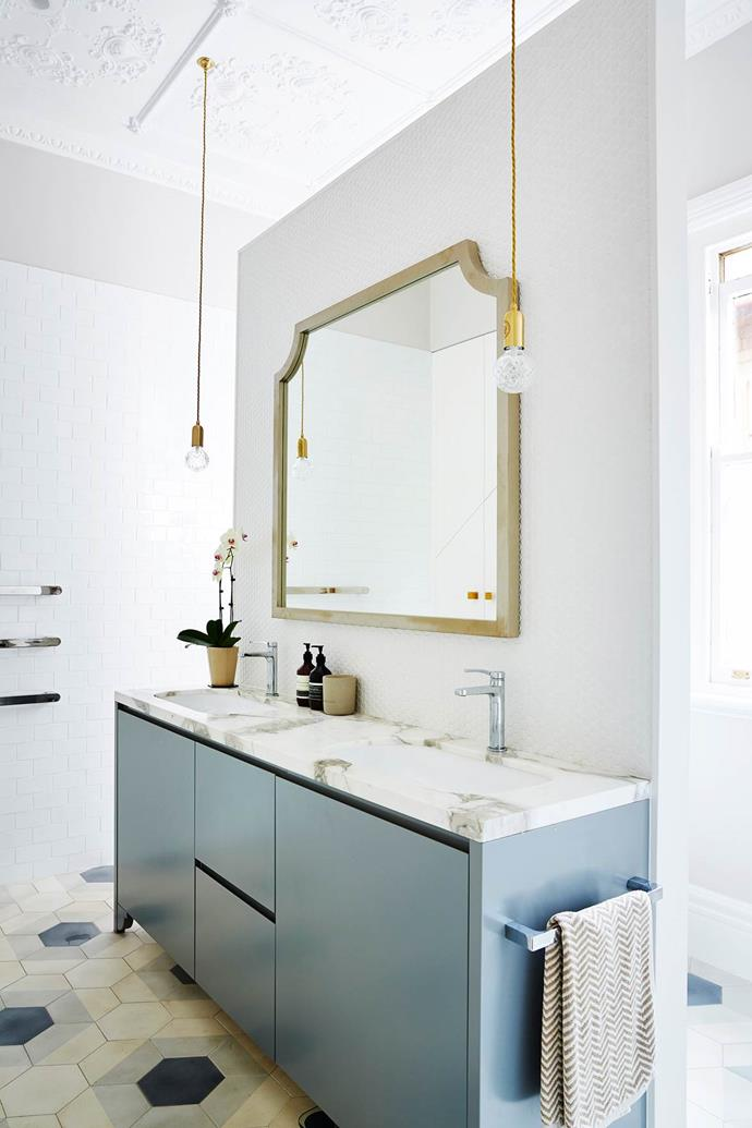 "Blue joinery creates a sense of calm in this [elegant ensuite](https://www.homestolove.com.au/federation-home-brought-to-life-with-colour-4800|target=""_blank"") that features a deft blend of marble, mosaics and brass."