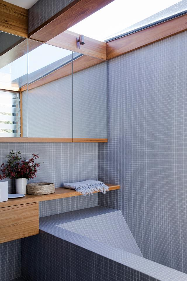 "This [chic ensuite](https://www.homestolove.com.au/sustainable-house-design-19409|target=""_blank"") boasts a spa-like feel thanks to the blue tiling and wooden accents. The bath is made from formed concrete."