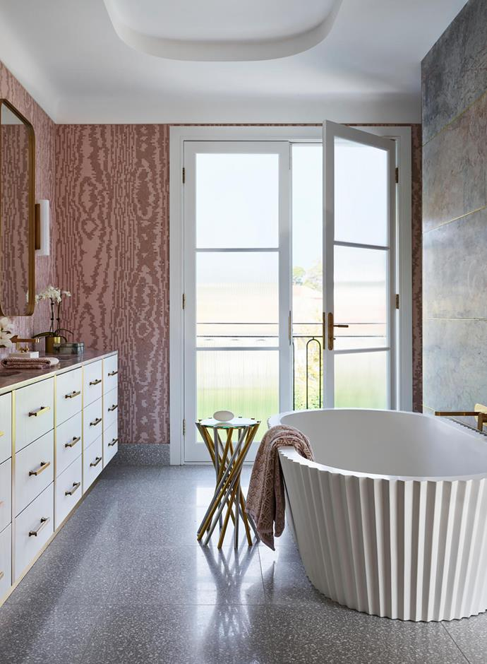 Bisazza 'Moire' tiles in Rose by Greg Natale. Flooring Honed Italian terrazzo from Surface Gallery. 'Electrum' accent table in Brass and Chrome from Jonathan Adler.