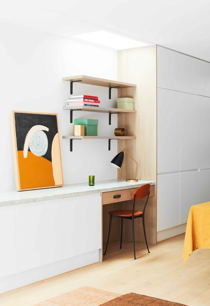**Kitchen** Every inch of cupboard space has been utilised, with shelves and drawers that can be adapted to store different things. Artwork by Jordana Henry.