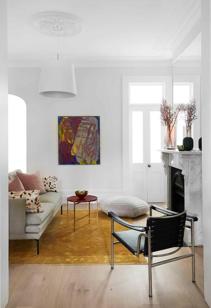 """**Formal living** Light-framed furniture makes this small space at the front of the house look blissfully uncluttered. The fireplace is original. Sofa, clients' own. Fogia 'Poppy' pouf, [Fred International](https://fredinternational.com.au/