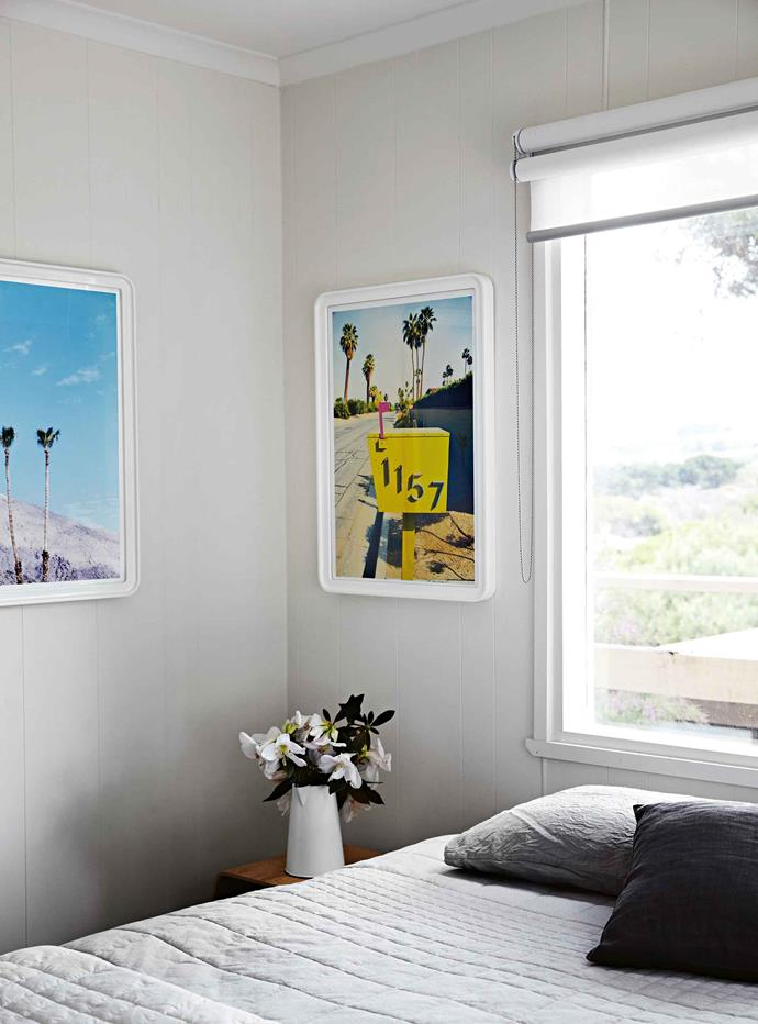 A restful bedroom decorated with images of Palm Springs.