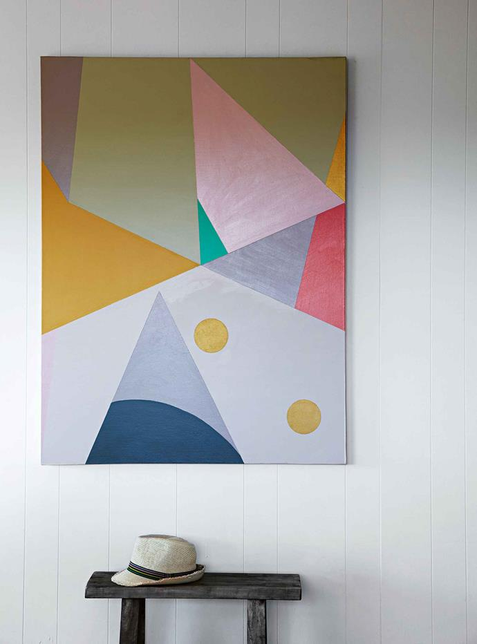 "Kaleidoscope, a painting by Amber, hangs in the [entrance hallway](https://www.homestolove.com.au/entrance-and-hallway-ideas-to-inspire-5111|target=""_blank""). Amber thinks the timber-clad two-storey house was probably built in the 1970s as two self-contained apartments with external stairs, and had been used as a rental house. Amber studied graphic art and design, and her framed screen-prints brighten up the walls. ""It's my hobby and I need to have creative interests, like my art and styling. """