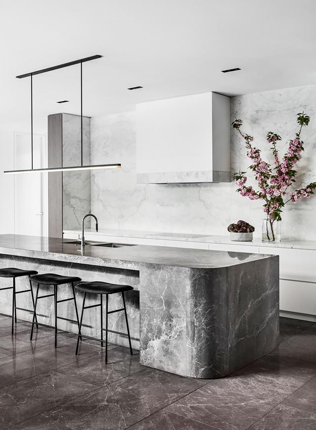 "This [kitchen by Miriam Fanning](https://www.homestolove.com.au/timeless-timber-and-stone-kitchen-20596|target=""_blank"") of Mim Design, a finalist in the 2019 Sub-Zero International Kitchen Design Contest, exudes confidence through its robust but beautiful materials, top-of-the-range appliances and specifically designed elements. Part of the island bench is carved from solid stone."