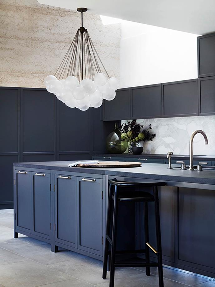 "Designer Alexandra Donohoe Church says ""The brief for the house in general required the marrying of two differing aesthetics – one half of the client couple's English sensibilities called for traditional detailing and colour palette, while the other's preferences were more contemporary, almost industrial. This kitchen is a compromise between the two, pairing traditional detailing with clean lines and contemporary pendant lighting."""