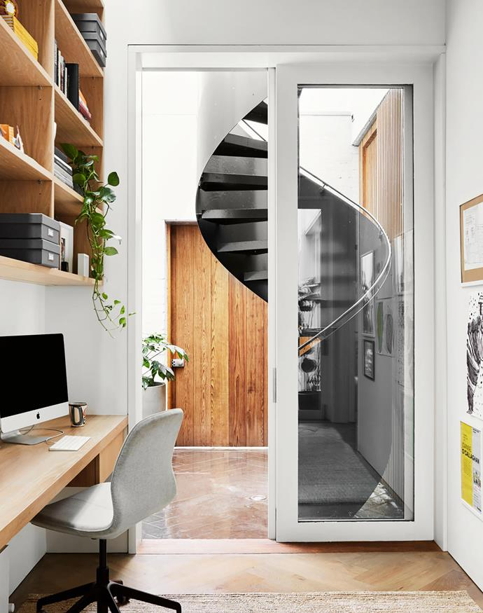 Built-in joinery maximises useable space in this nook, which is tucked into a corridor between the kitchen and laundry. Desk chair, Ikea.