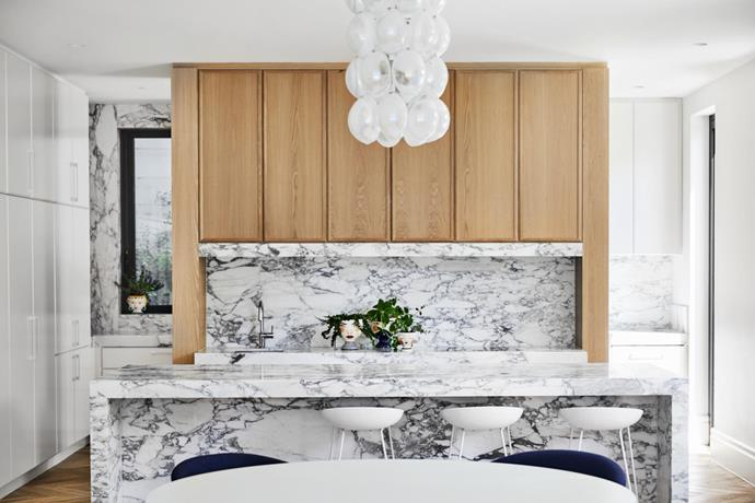 Arabescato marble from Signorino is the star of this luminous kitchen by architect Maria Danos and interior designer Simone Aiello.