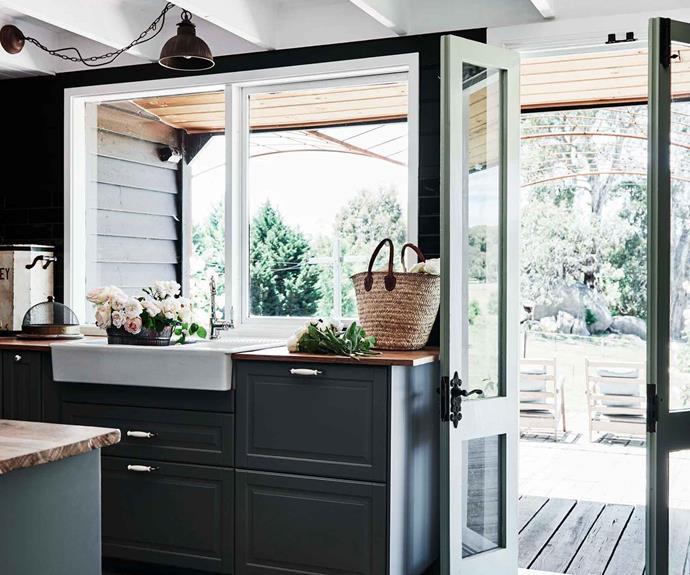 Country kitchen with deep green cabinetry