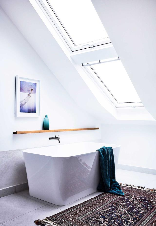 "Lit by a skylight, the Victoria + Albert ""Edge"" bath provides the perfect place to relax and unwind in this [bright abode](https://www.homestolove.com.au/northern-beaches-home-renovation-19164