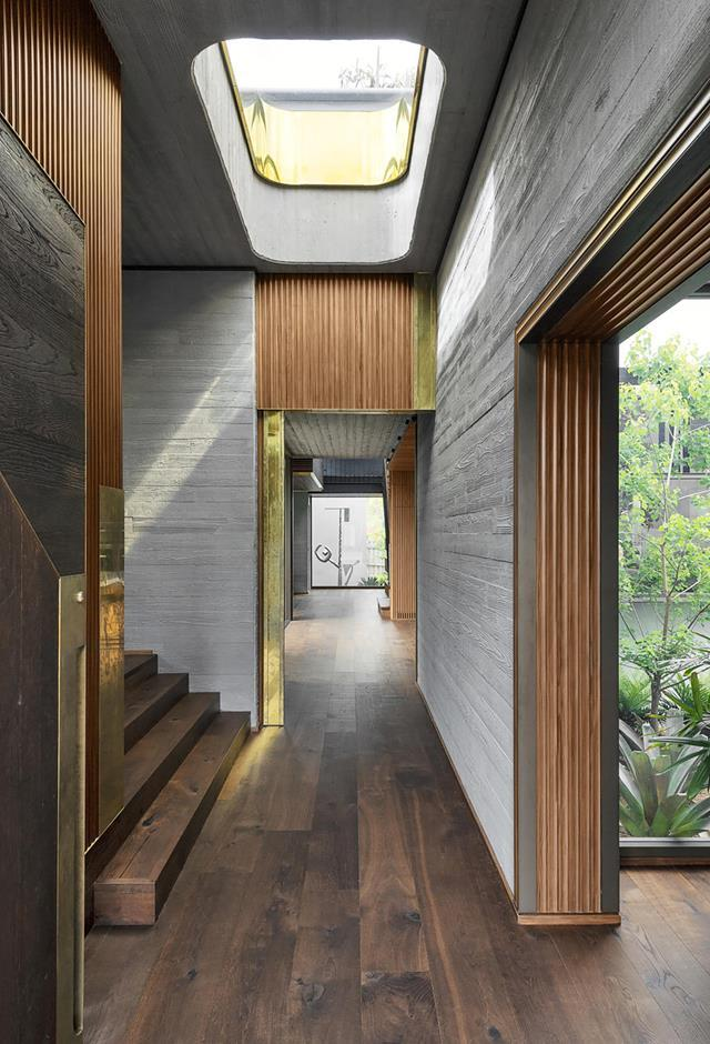 "A skylight illuminates the textured materials such as matt cement and ribbed timbers which set the mood as you walk through this [modernist house](https://www.homestolove.com.au/a-concrete-house-with-modernist-lines-19654|target=""_blank"")."