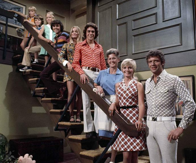 "The Brady Bunch standing on the steps in their home. The stairs came to symbolise family unity when mother Carol (played by Florence Henderson) told Bobby ""the only steps in this house are those (shows Bobby the stairs), the ones that lead up to your bedroom."""