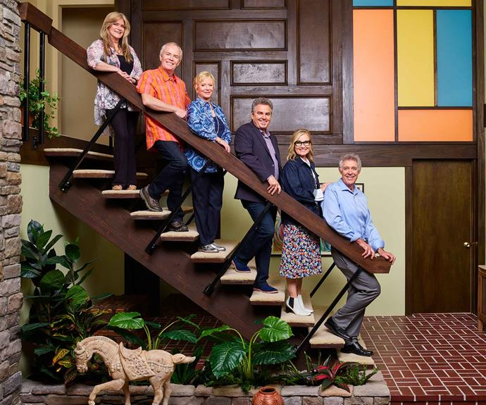 The Brady Bunch family recreating the iconic staircase shot. Pictured from left to right: Susan Olsen (Cindy), Mike Lookinland (Bobby), Eve Plumb (Jan), Christopher Knight (Peter), Maureen McCormick (Marcia) and Barry Willliams (Greg).