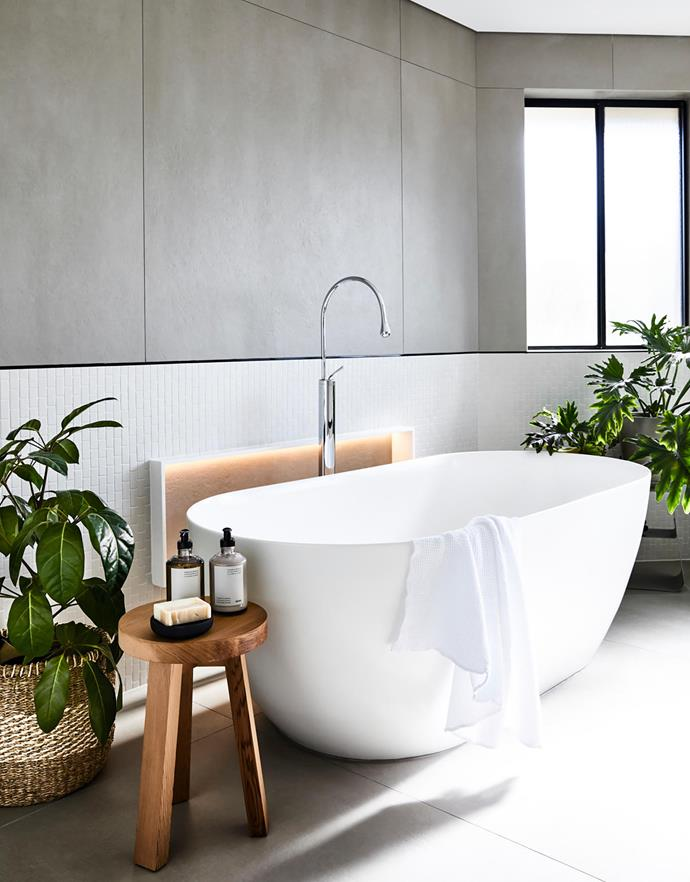 Gareth Ashton 'Byron' 1690mm freestanding bath, $3905, from Minosa. Gessi 'Goccia' floor-mounted bath filler and mixer, $2198, wall-mounted spout and mixer, $1480, Minosa. Inax glazed-porcelain mosaic tiles, $125.40/m², Artedomus. Cedar stool, $344, Ume soap dish, $40, from Oliver Thom. Stripe seagrass basket, $75, Garden Life.