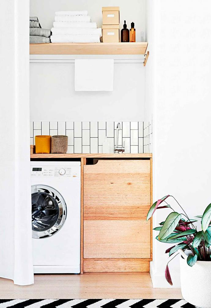 In this pared-back laundry suspended wires add hanging space.