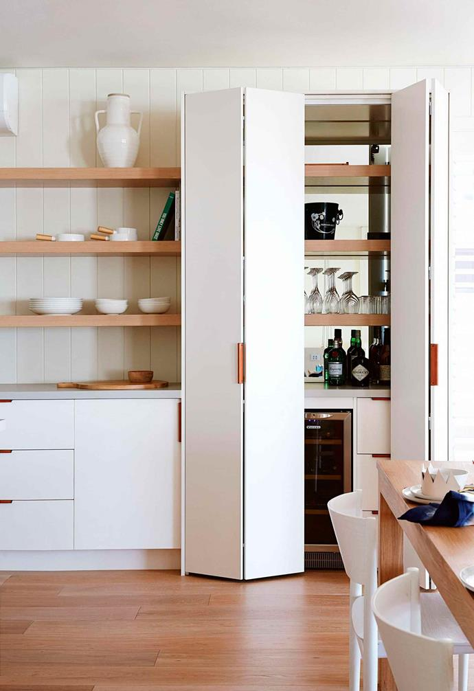 "Clever custom joinery in the kitchen space of this revamped [Scandi-style home](https://www.homestolove.com.au/scandi-style-glass-house-extension-17515|target=""_blank"") has created a separate pantry nook and additional prep-space."