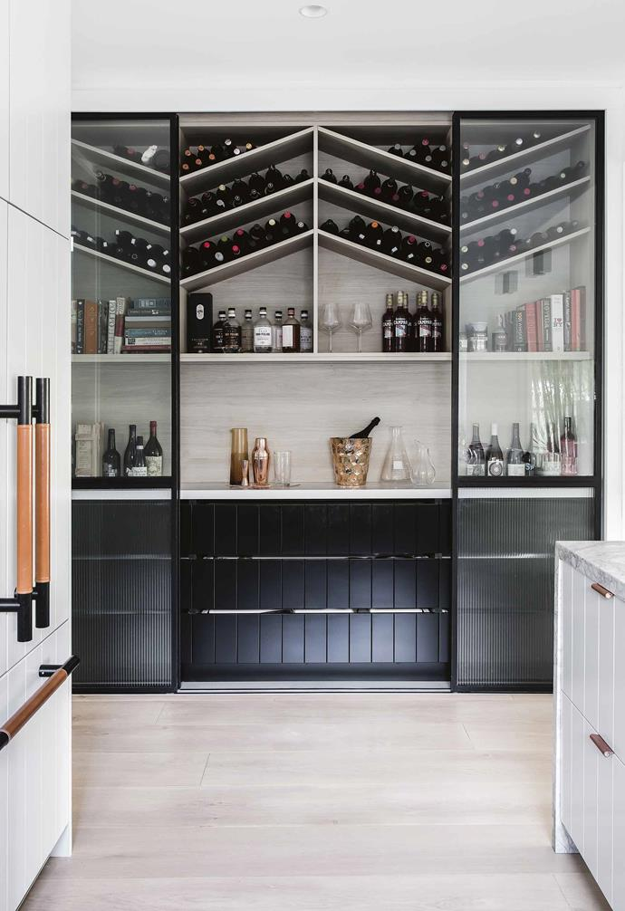 "While technically not a butler's pantry, we love this incredible wine storage space in this [revamped weatherboard cottage](https://www.homestolove.com.au/bellamumma-nikki-yazxhi-home-tour-16880|target=""_blank""). The nook adds additional bench space to be used when entertaining, as well as providing additional storage when needed."