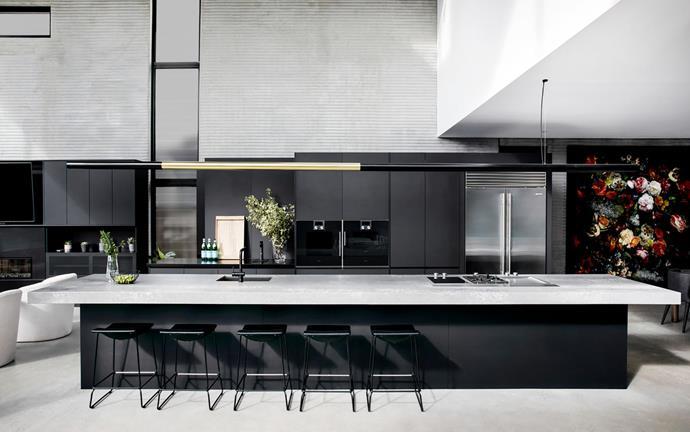 Polytec Venette cabinetry in Supa Black, Freedom Kitchens Designer Range. Rear benchtop in Caesarstone Jet Black, from $450/m² (installed). French-door fridge, Sub-Zero.