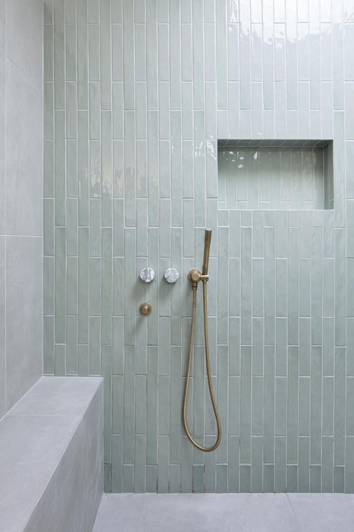 "Design elements from the main bathroom, such as the vertically laid tiles, brass fixtures and recessed shelves, flow into the ensuite to help create a sense of cohesion. ""I fell in love with the tiles and then built the choices from there,"" Bec says. Marble wall taps add just the right amount of luxe."