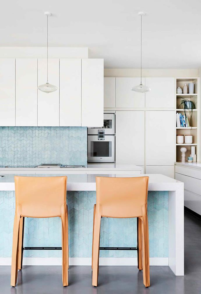 "With turquoise mosaic tiles creating a bold statement in the kitchen of this [renovated Edwardian home](https://www.homestolove.com.au/edwardian-house-interior-colours-19813|target=""_blank"") its easy to overlook the butler's pantry tucked neatly behind. Heavy duty appliances and ample storage space ensure that the principal kitchen space is left neat and tidy when guests visit."