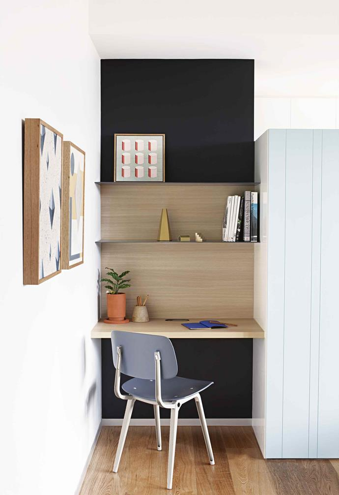 **Surface style** <br><br>Colour and contrast can define your study zone. Here, the dark paint shade above and below the desk means those sections recede visually, allowing the timber veneer desk and shelves to 'float'. Yes, it's minimal, but there is a tall tuck-away storage cupboard to the right.<br><br>