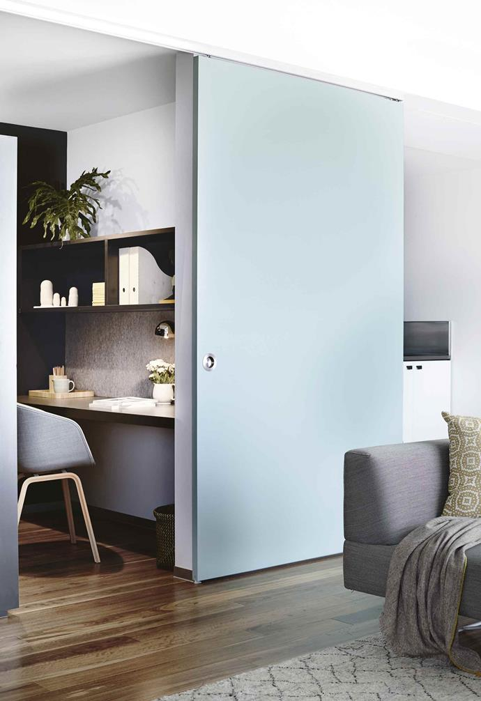 **Slide and hide** <br><br>A large sliding panel is used to screen off the work area or the small adjoining kitchen in this compact and flexible Melbourne apartment. You'll need to prioritise lighting if your office space is entirely internal.<br><br>
