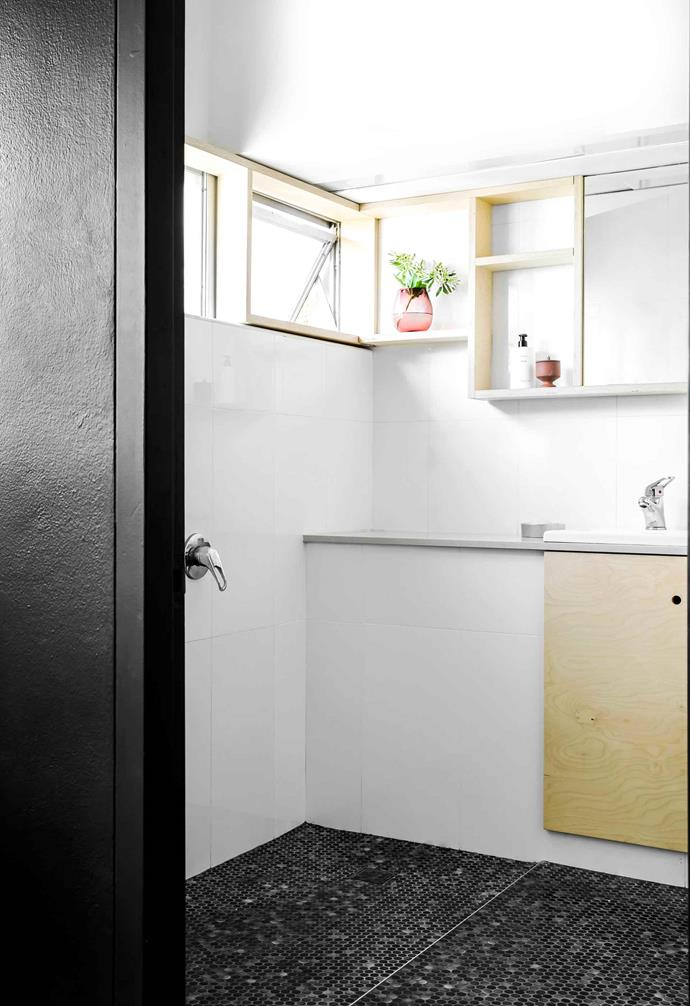 "**Bathroom** All they did in here is add new floor tiles and a bifold door. seed vase in rose, [Jardan](https://www.jardan.com.au/|target=""_blank""
