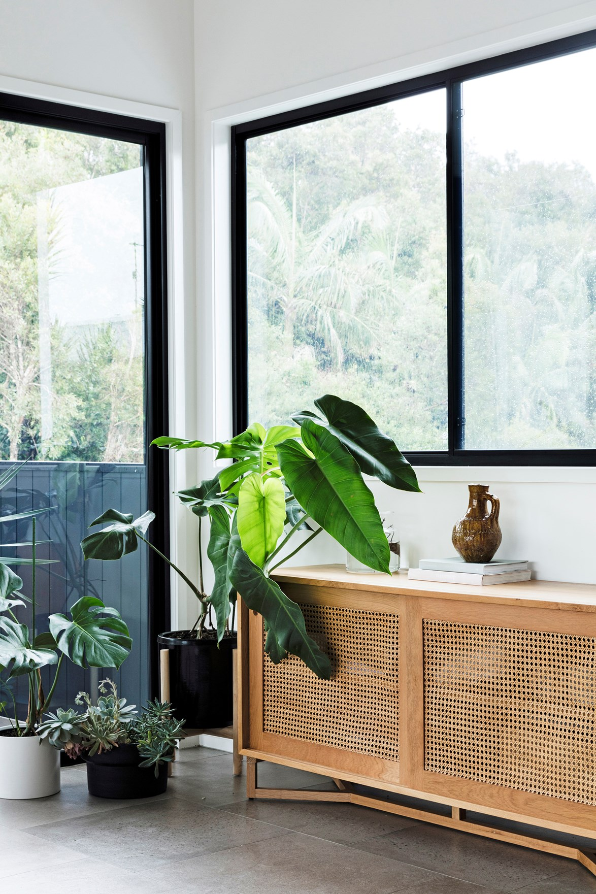 If you prefer to keep things minimal, indoor plants, handcrafted ceramics and a couple of books is all you need to style your sideboard.