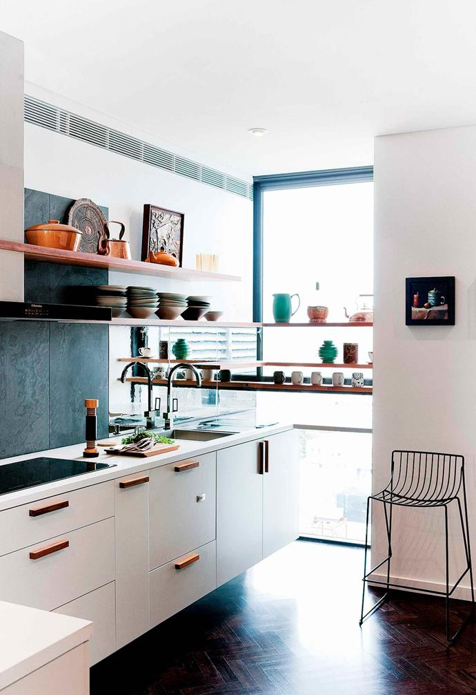 """By placing open shelving across the window this kitchen has gained [more storage space](https://www.homestolove.com.au/small-kitchen-storage-ideas-18922 target=""""_blank"""") without cutting out the [natural light](https://www.homestolove.com.au/how-to-increase-natural-light-in-home-15836 target=""""_blank"""")."""