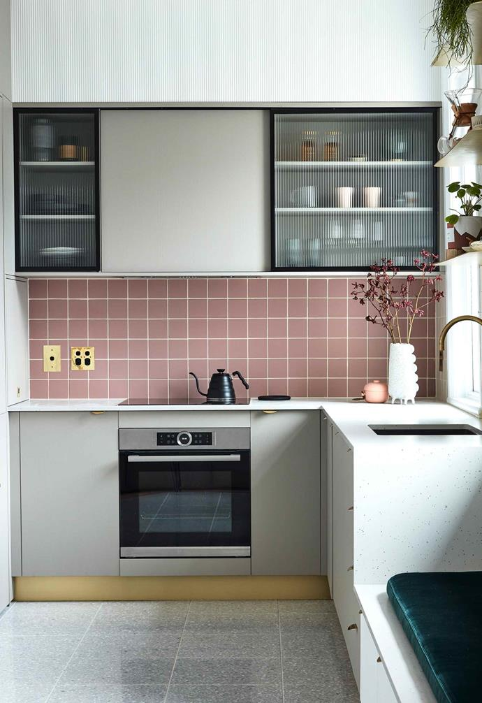 "In the compact kitchen of this [Sydney apartment](https://www.homestolove.com.au/small-apartment-design-ideas-20593|target=""_blank"") clever custom joinery provides ample storage throughout. In the corner cabinet below, hinged shelves inside swing outwards for ease of access and use."