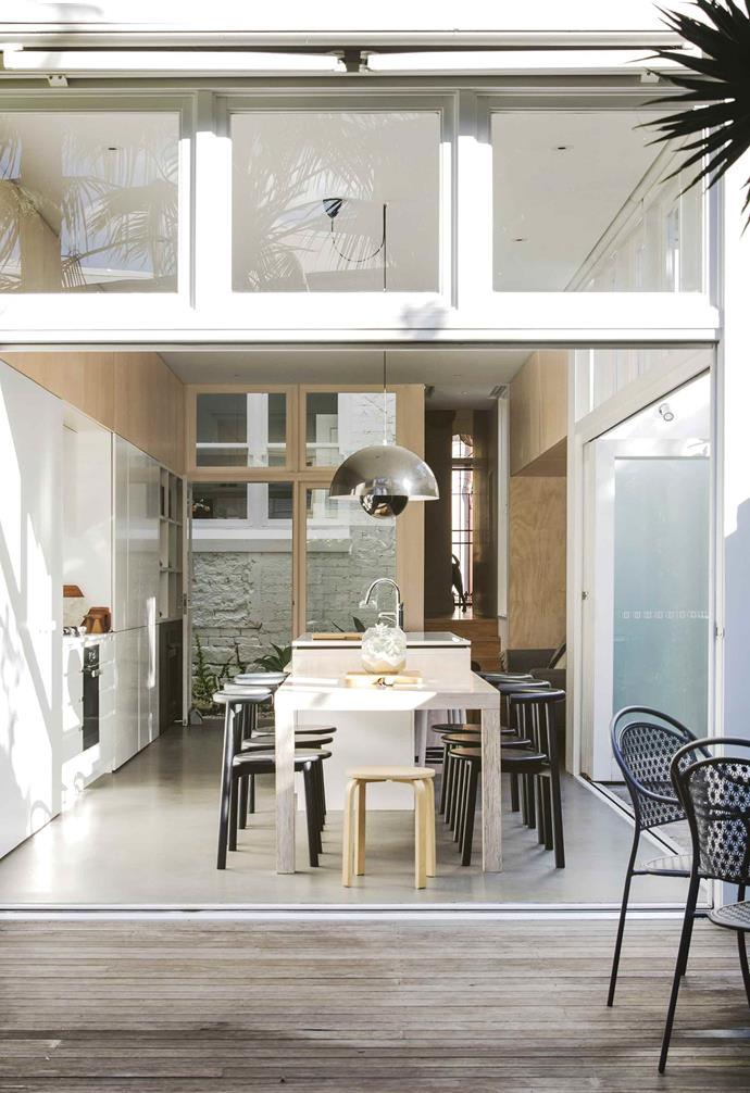 """In this [compact Paddington terrace](https://www.homestolove.com.au/relaxed-terrace-paddington-18366 target=""""_blank"""") in order to conserve space a custom dining table was built to connect with the kitchen island, transforming it into a multi-functional space."""
