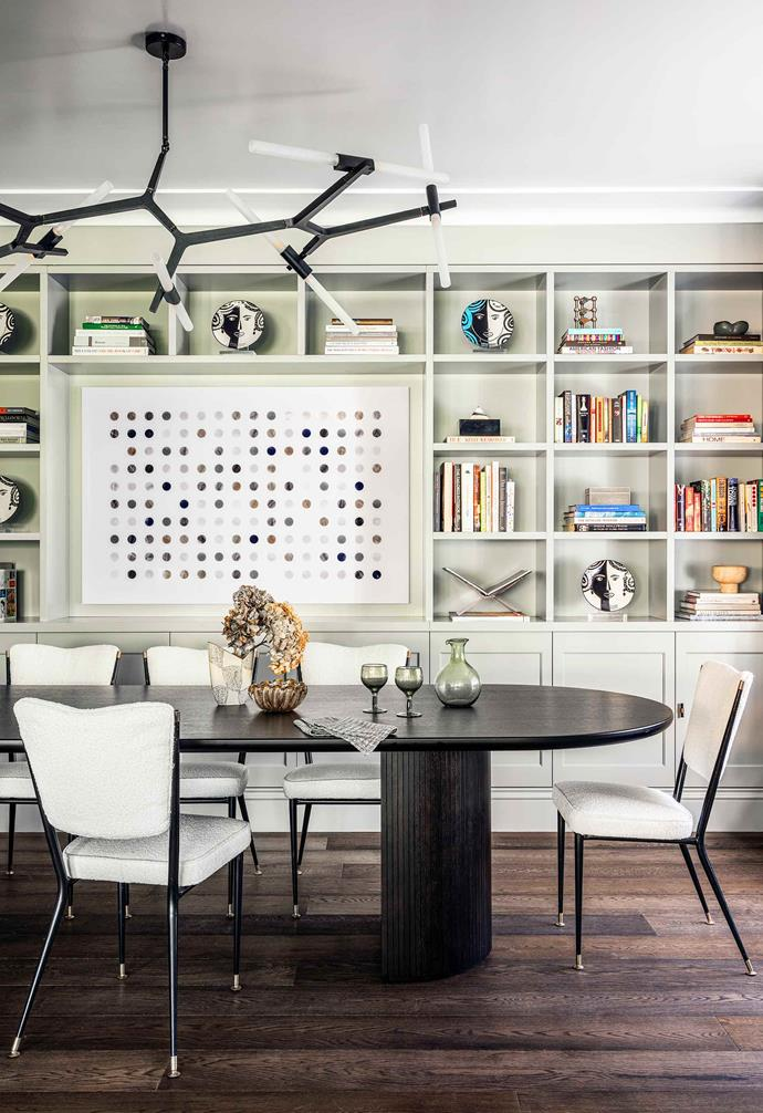 "**Dining room** Melissa and Jeremy love to entertain and wanted a separate dining area. In order to use the room more often they combined it with a library and home office. The Gubi 'Moon' table from [Criteria](https://criteriacollection.com.au/|target=""_blank""