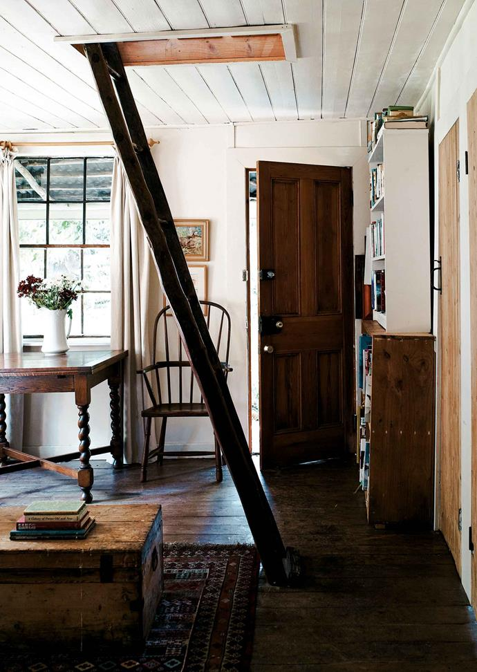 "Access to the upstairs bedrooms is from the sitting room, via an old orchard ladder. The rooms have great charm, though looking at the old cherry-picking ladder propped in the roof opening, it's obvious that these sleeping quarters are only for those with a degree of agility. Indeed, Lydia observes, ""I love my bed up there but you have to be careful you don't fall down the ladder."""