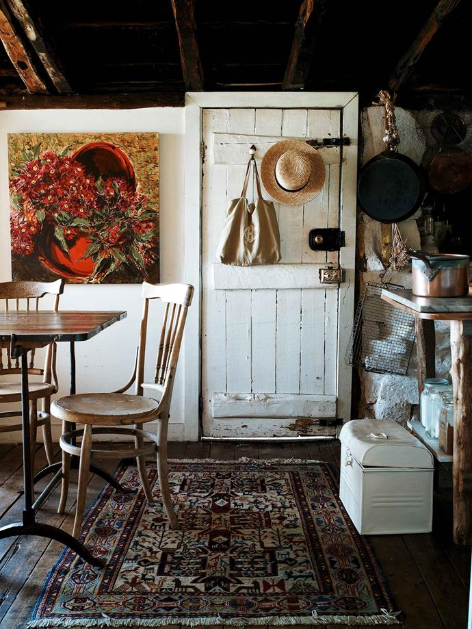 "The rustic kitchen and dining room. The [farmhouse](https://www.homestolove.com.au/farmhouse-kitchens-20204|target=""_blank"") was built around 1880 and had been owned by just one family. While the property had been subdivided, the cottage landholding, then surrounded by old cherry orchards, still extended to 30 hectares. The settlers built in true vernacular style, says Lydia, using whatever they could lay their hands on."