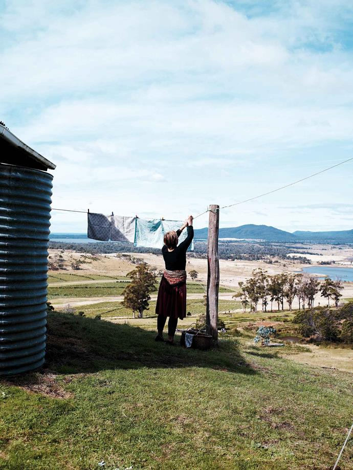"Hanging out the washing with a view to the Freycinet Peninsula. ""We call it the 'Little House on the Prairie', because when everyone goes to bed there's all this calling out of 'goodnight'!"" For Lydia, it's the place where she can really relax. ""Once when I was pregnant we lived here for six months and I had a [cottage garden](https://www.homestolove.com.au/cottage-garden-20688