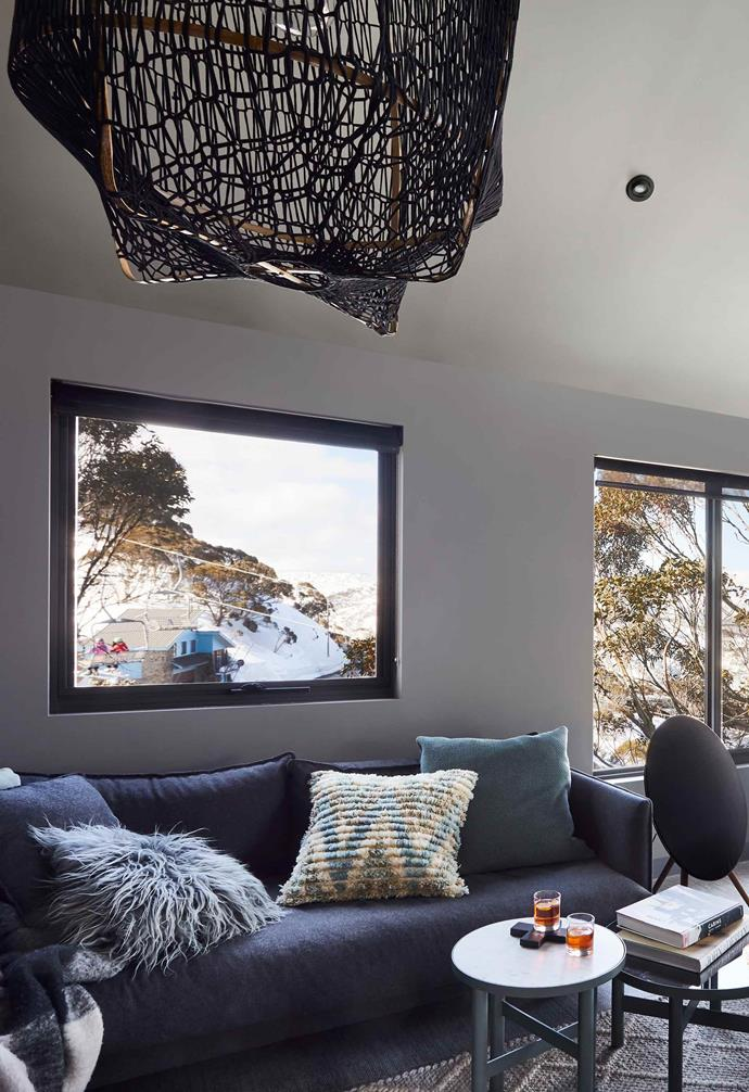 "**Living area** Tantalising views of Mount Hotham are framed by the new aluminium windows. The family's [Bang & Olufsen](https://www.bang-olufsen.com/|target=""_blank""