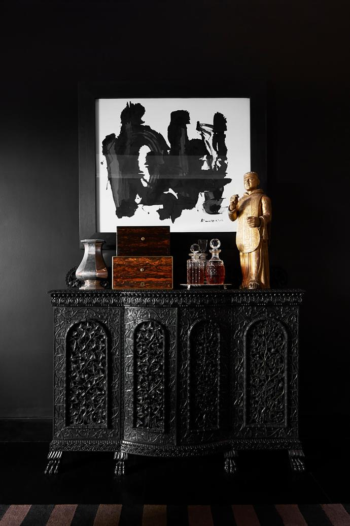 A painting by H.A Karunaratne hangs above an intricately hand-carved rosewood Indo-Portuguese cabinet in the main bedroom.